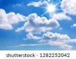 a blue sky with sun  sunbeams... | Shutterstock . vector #1282252042