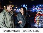 night portrait of a happy... | Shutterstock . vector #1282271602