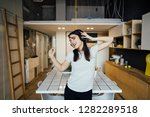cheerful woman listening to... | Shutterstock . vector #1282289518