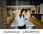 cheerful woman listening to... | Shutterstock . vector #1282289542