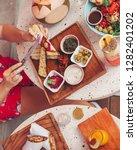sharing hummus platter   Shutterstock . vector #1282401202