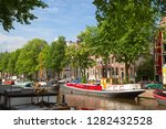 amsterdam   july 10  canals of... | Shutterstock . vector #1282432528