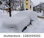 snowbound car in snowy reit im...   Shutterstock . vector #1282434202