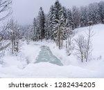 creek in the snowy reit im...   Shutterstock . vector #1282434205
