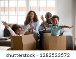 happy african american parents... | Shutterstock . vector #1282523572