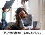african american single mom... | Shutterstock . vector #1282524712