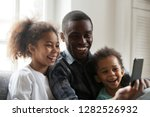 happy african american dad... | Shutterstock . vector #1282526932
