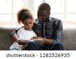 caring happy african dad... | Shutterstock . vector #1282526935