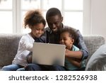 happy african father and little ... | Shutterstock . vector #1282526938