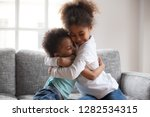 cute happy african american... | Shutterstock . vector #1282534315