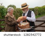 1940s delivery man and elderly... | Shutterstock . vector #1282542772