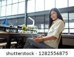 happy freelancer asian woman... | Shutterstock . vector #1282556875