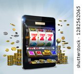 3D Illustration of a gambling slot machine popping out from a tablet screen to reveal a jackpot combination. Gambling concept image suggesting the idea of playing video slots games at online casinos. - stock photo