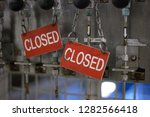 red and white dirty closed sign....   Shutterstock . vector #1282566418