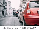 cars parked on street in... | Shutterstock . vector #1282579642