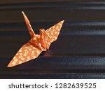 paper folded into a lucky bird. ...   Shutterstock . vector #1282639525