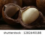 roasted macadamias on wooden... | Shutterstock . vector #1282640188