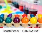 freshly colored easter eggs... | Shutterstock . vector #1282665355