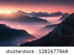 mountains in fog at beautiful... | Shutterstock . vector #1282677868