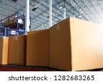 cardboard boxes on conveyor belt | Shutterstock . vector #1282683265