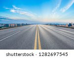 empty asphalt road and city... | Shutterstock . vector #1282697545