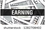 earning closeup concept.... | Shutterstock . vector #1282708402