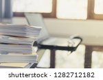 pile of unfinished documents on ... | Shutterstock . vector #1282712182