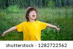 happy boy in rain summer... | Shutterstock . vector #1282722562