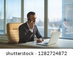 the businessman phones at the... | Shutterstock . vector #1282724872