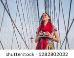 smiling woman with a retro... | Shutterstock . vector #1282802032