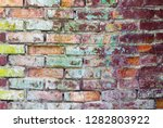 grunge colored brick wall. old... | Shutterstock . vector #1282803922