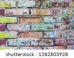 grunge colored brick wall... | Shutterstock . vector #1282803928