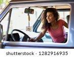 arab woman inside an old van... | Shutterstock . vector #1282916935