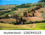 charming landscape with a car... | Shutterstock . vector #1282943125