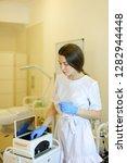 nice cosmetologist in latex... | Shutterstock . vector #1282944448