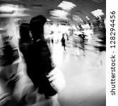 fashion women in shopping center abstract blur black and white - stock photo