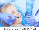 little girl sitting in the... | Shutterstock . vector #1282950178