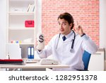 young doctor working in hospital   Shutterstock . vector #1282951378