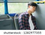 passenger sleeping inside a... | Shutterstock . vector #1282977355