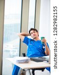 young handsome doctor working...   Shutterstock . vector #1282982155
