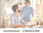happy middle aged colleagues in ... | Shutterstock . vector #1283022508