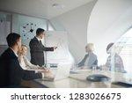 confident businessman in... | Shutterstock . vector #1283026675