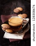 Cup of coffee and chocolate cookies on a dark wooden background. - stock photo
