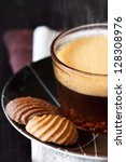 Cup of coffee and chocolate cookies on a dark wooden background close-up. - stock photo