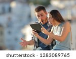 amazed friends finding online... | Shutterstock . vector #1283089765