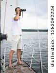 bearded man watching binocular... | Shutterstock . vector #1283092228