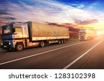 big trucks and white trailers... | Shutterstock . vector #1283102398