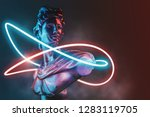 Style Statue Background Neon...