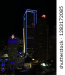 Small photo of Dallas, Texas - December 16, 2018: Downtown - Whitacre Tower, Magnolia Hotel with Neon Pegasus, The Joule Hotel