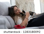 close up of female owner... | Shutterstock . vector #1283180092